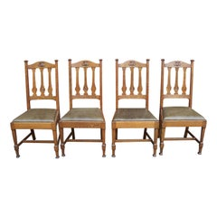 Shapland & Petter, Four Arts & Crafts Oak Dining Chairs with Floral Details