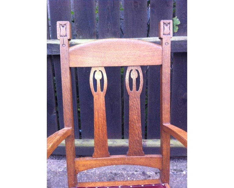 English Shapland & Petter Substantial Arts & Crafts Oak Armchair with Floral Decoration For Sale
