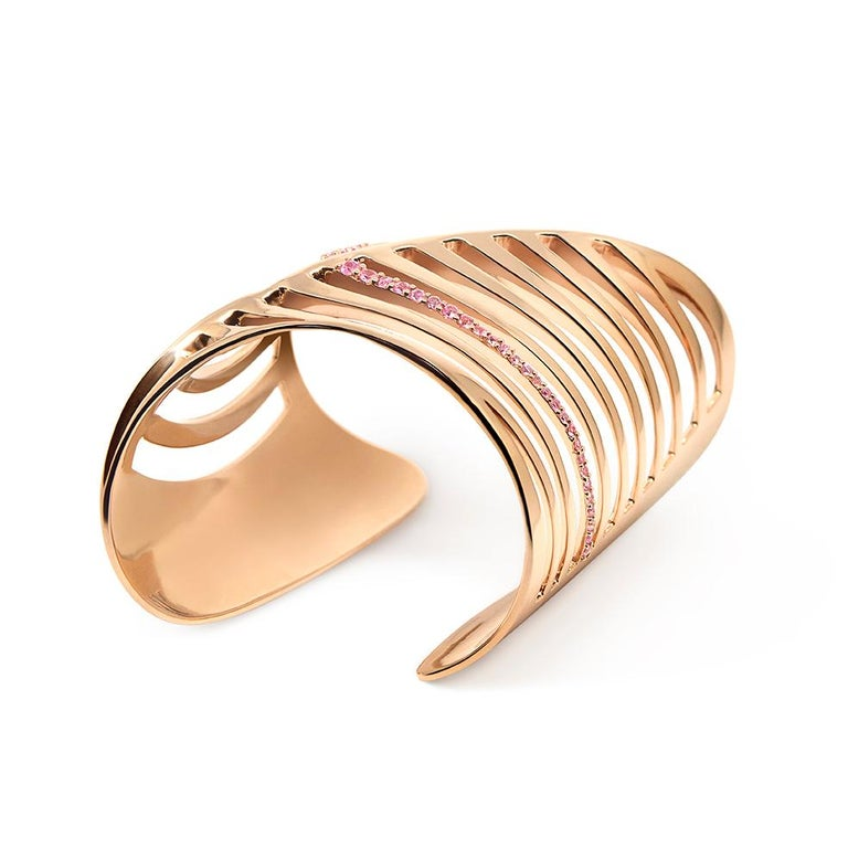 Limited edition cuff bracelet with an architectural look The design is inspired by a fusion of a modernist-futurist architecture from the 1970s and the body of the shark, predator of the ocean. It has cuts in an abstract fishbone pattern. Shaped to