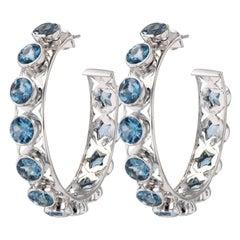 Shari Hoop Earrings in White Gold with 6.40 Carat London Blue Topaz Gemstones