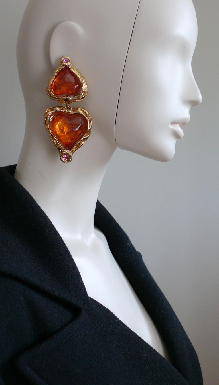 SHARRA PAGANO vintage oversized gold toned resin dangling earrings featuring hearts embellished with irregular orange resin cabochons and pink crystals.  Embossed SHARRA PAGANO (only on the reverse of one earring / see photos).  Indicative