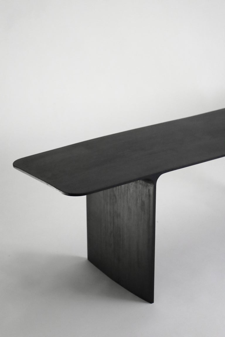 Shave bench Hand-sculpted and signed by Cedric Breisacher Materials: Oak , Oxyde black Dimension: L 140 x l 42 x H 45 cm can be made to order in other width.  Designer-sculptor, Cedric Breisacher has an atypical path. Self-taught man, he followed