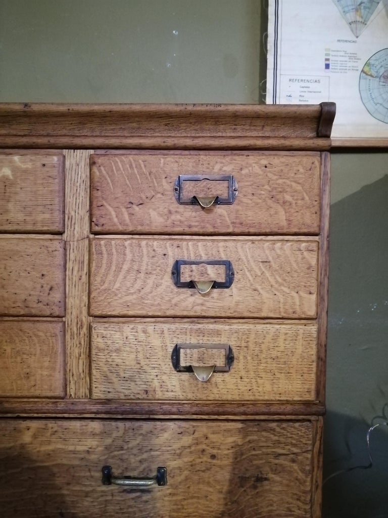 Rare American oak stacking cabinet with drawers by Shaw Walker. The upper body's 9 drawers have brass label handles. The lower body's 4 drawers show regular pulls. It shows the brand sticker on the upper body.