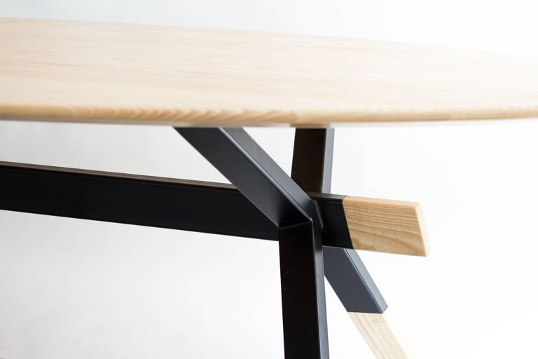 The Shawii table was originally commissioned by a private design collector who wanted a high capacity, solid table, with Mid-Century Modern aesthetics. The result is a versatile, strong and durable table with soft lines. The table is composed of