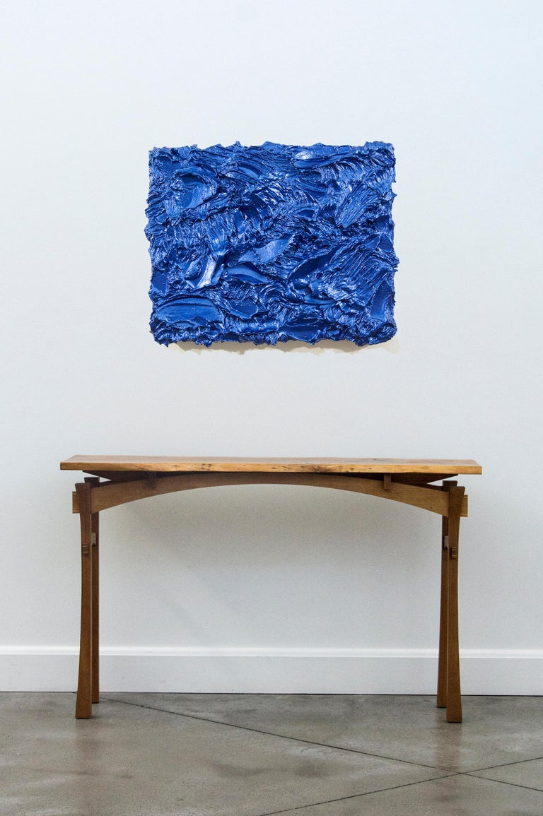 In thick, textured layers of eye-popping metallic blue pigment, Shayne Dark sculpts this Storm Surge painting into a tactile three dimensional object. The dynamic energy of this work is enhanced by its glossy, reflective surface.   Shayne Dark has