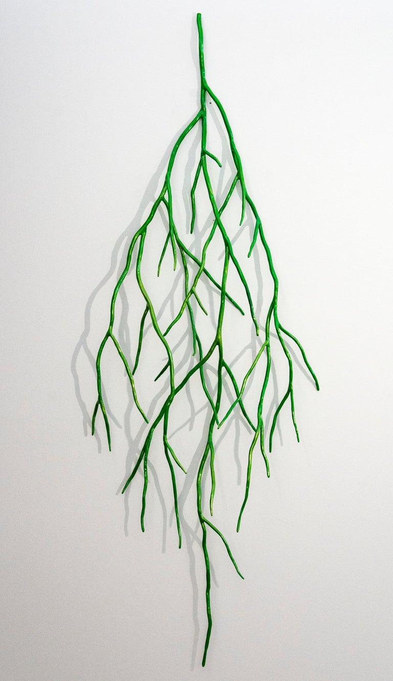 This striking, metallic candy apple green steel bough by Shayne Dark resembles a network of dangling branches. Poised between representation and abstraction, this intricate hand forged wall sculpture is saturated in eye-popping pigment.   Evocative