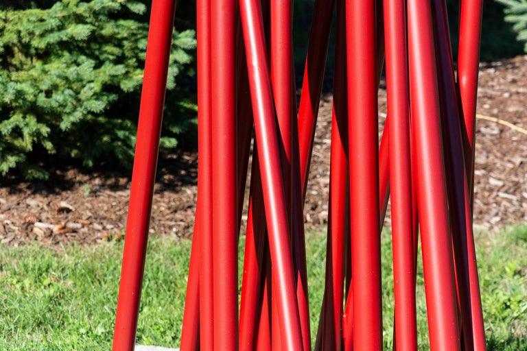 Intersecting spires of deep red emerge from the ground evokingthe notion of fire. This abstract powder coated sculpture by Shayne Dark is suitable for outdoors and indoors exhibition.   Poised between abstraction and representation, the artworks of