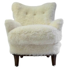 Shearling Covered Shaped Back Chair with Wood Base and Legs with Metal Cap Feet