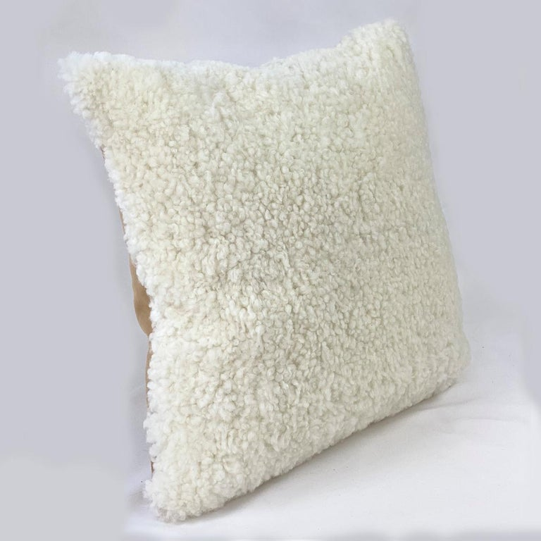 Add a refreshing touch to your interior with this white shearling sheepskin pillow. The sheepskin wool features a curly short wool pile that will add inviting and charming textures to a room. Part of the boucle collection, this shearling pillow