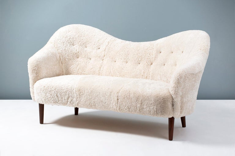 Carl Malmsten 'Samspel' sofa  This iconic piece of Swedish furniture was designed in 1956 by master cabinetmaker Carl Malmsten. It was produced by AB Record in Bollnas, Sweden. This example has been reupholstered in luxurious Australian shearling