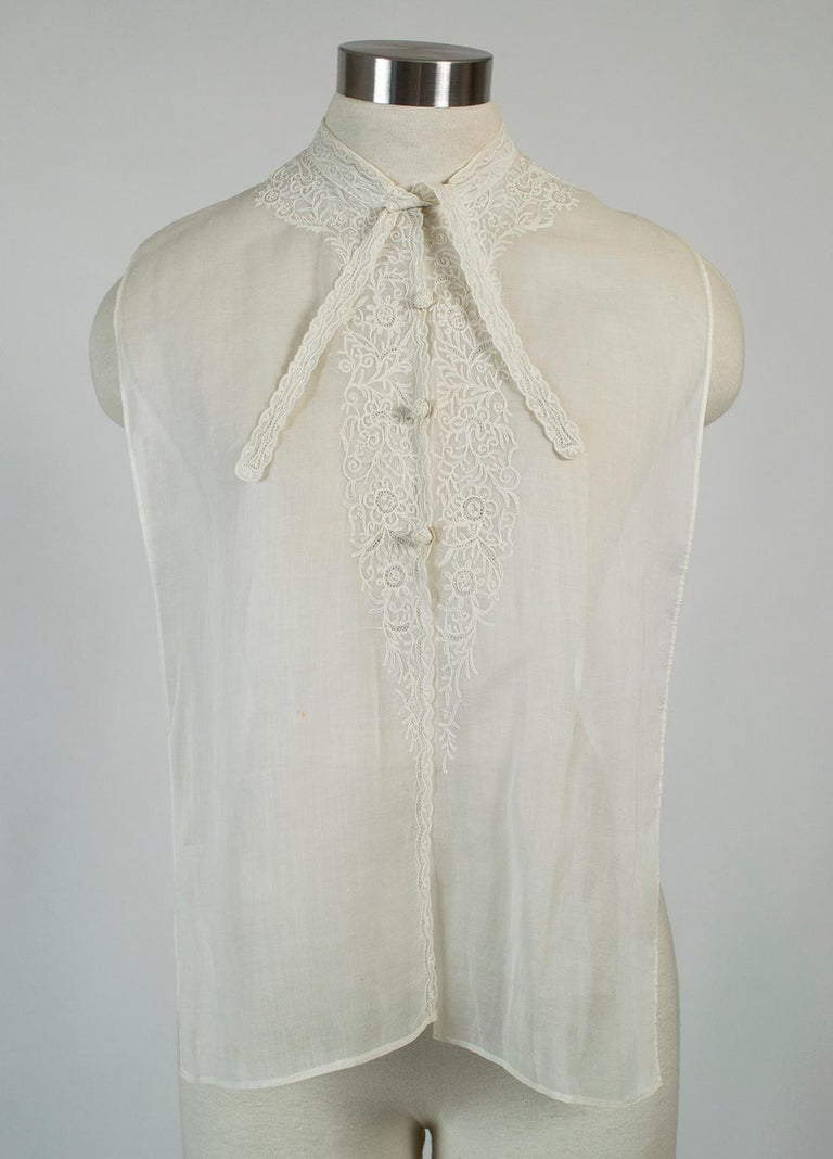 Indispensable accessories, neckcloths stretched the Edwardian woman's wardrobe by changing the look of a dress and covering the décolletage. Though it is over a century old, this whisper-light version looks modern thanks to its banded collar,