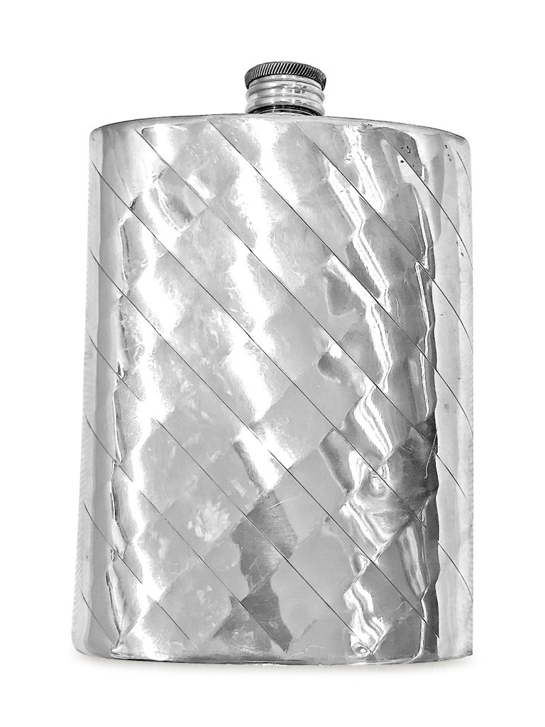 A beautiful 8 ounce  thermos made in Sheffield England . This English pewter thermos  has a diamond shape design by hand . W ; 1