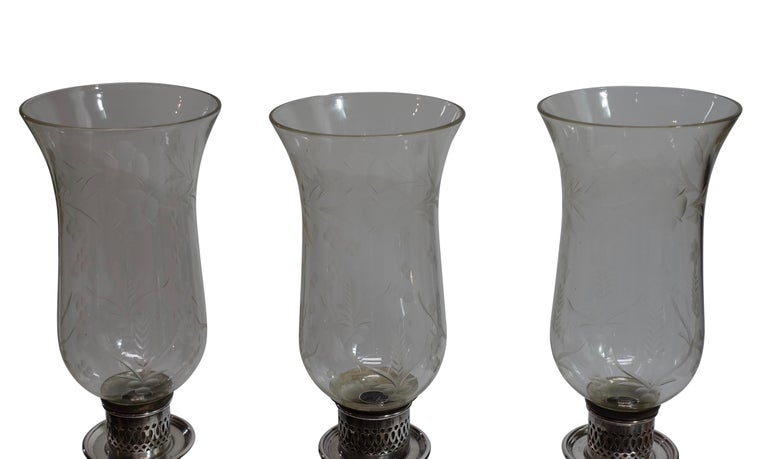 A fine and unique Sheffield silver plate on copper three light candelabra with etched glass hurricane shades, adjustable to a single candle stick. English, circa 1850.