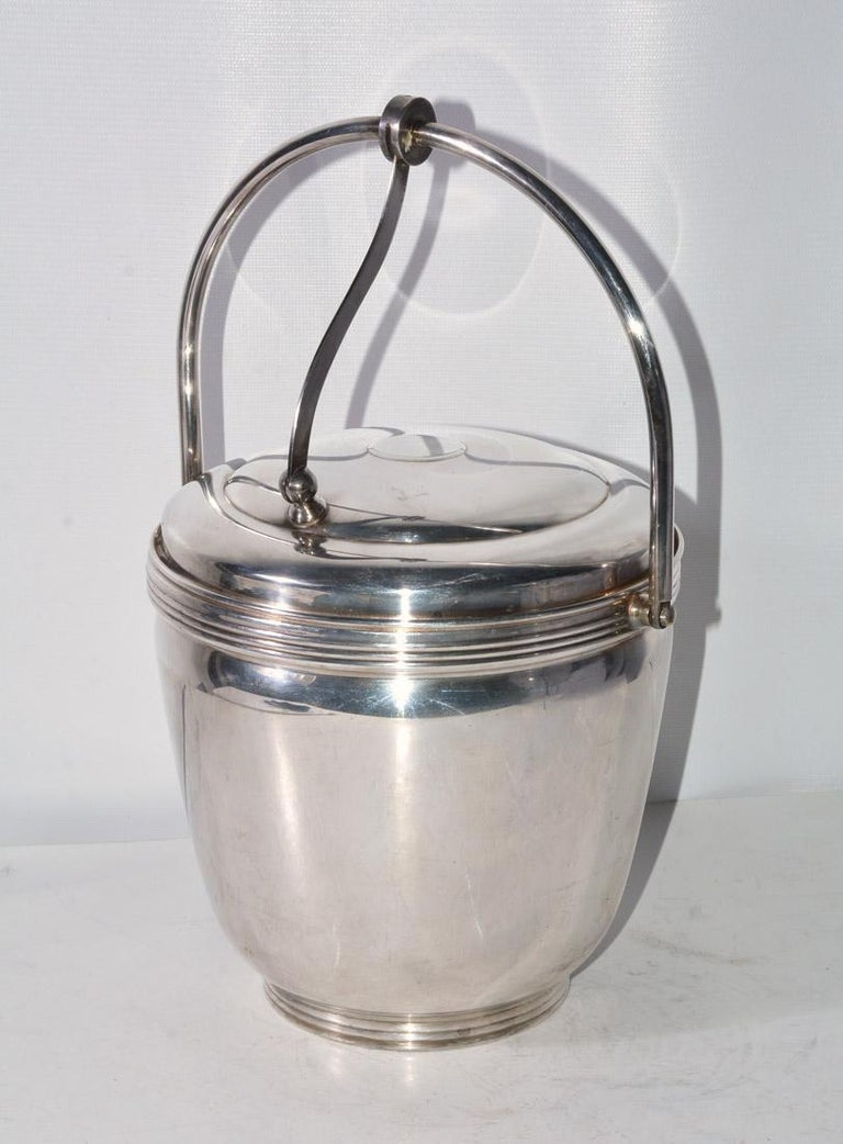 Lidded and handled ice bucket with glass insert, marked underside for The Sheffield Silver Company, Made in USA, holiday accessory, tableware, bar ware, Measures to handle top 13 inches, 9 inch diameter.