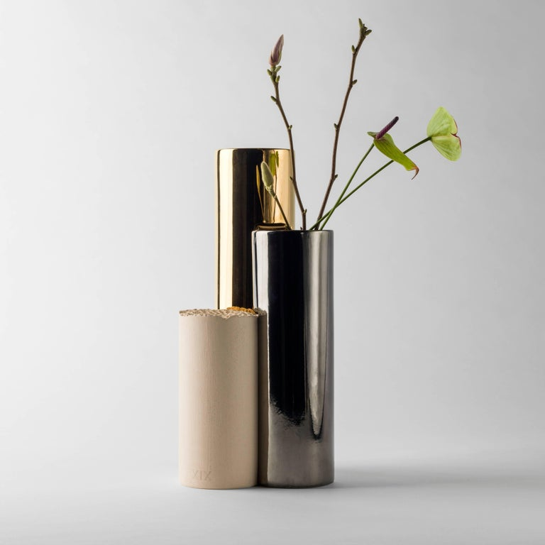 Is-Dher vases design by Sheikha Hind Bint Majid Al Qassimi.  24-carat gold plated enameled ceramic vase, platinum and a beige engobe.   Limited edition of eight units and two artist proofsand two prototypes.  Measure: 19 x 18 x 40 H