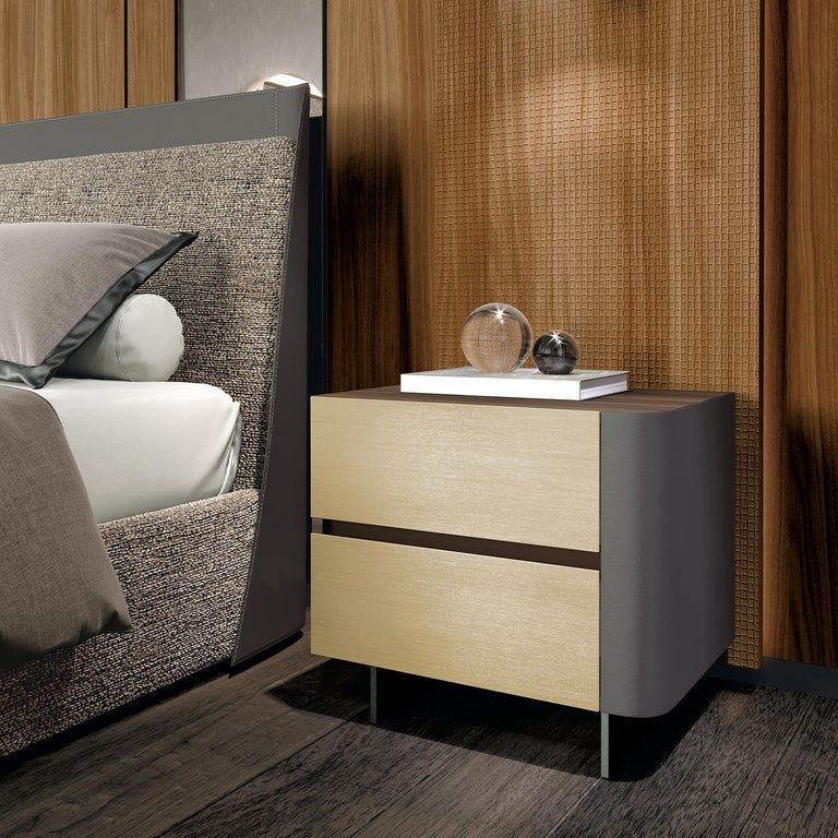 A rigorous, architectural geometry merge with a sleek, dainty flair to create this exquisite right-hand bedside table. It features two lacquered MDF drawers internally made of a blackboard of poplar veneered with Tanganyika walnut, and equipped with