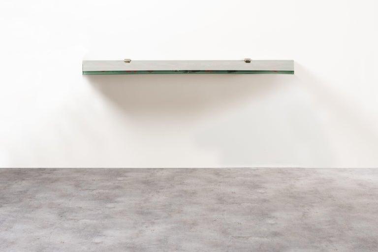 Shelf by Dube', Duilio Bernabe´, Italy, 1950s. Manufactured by Fontana Arte. Signed exemplar. Painted crystal, brass. Measures: 116.5 x 28.5x H 5 cm. 45.8 x 11.2 x H 2 in. Literature: F. De Boni, Fontana Arte, Pietro Chiesa, Gio Ponti, Max Ingrand,