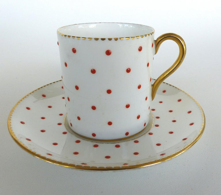 Shelley England Fine Bone China Enameled and Gilt Demitasse Cups and Saucers  Offered for sale is a set of five fine china cups and saucers from Shelly. Each cup and saucer is decorated with raised enamel dots and accented with gold. Cups measure