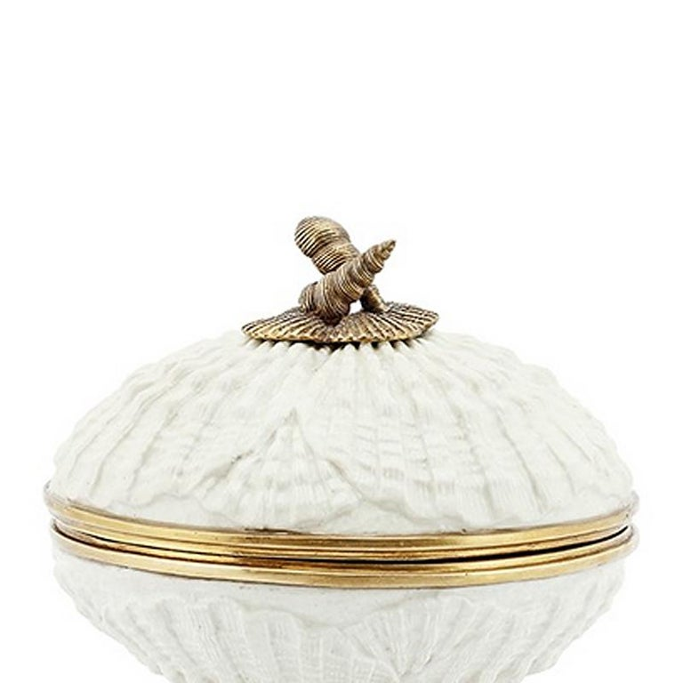 Box shells in hand-carved white porcelain with solid bronze details.