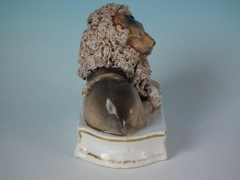 English Shelton Staffordshire Lion with Lamb Figure For Sale
