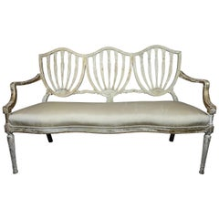 Sheraton Style Shield Back White and Gilt Painted Settee