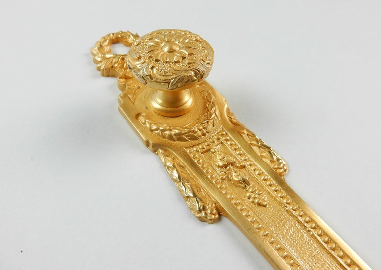 From the Sherle Wagner collection a rare ornate closet or cabinet pull knob with escutcheon. Both are 22-karat gold plated finish. Escutcheon is 8