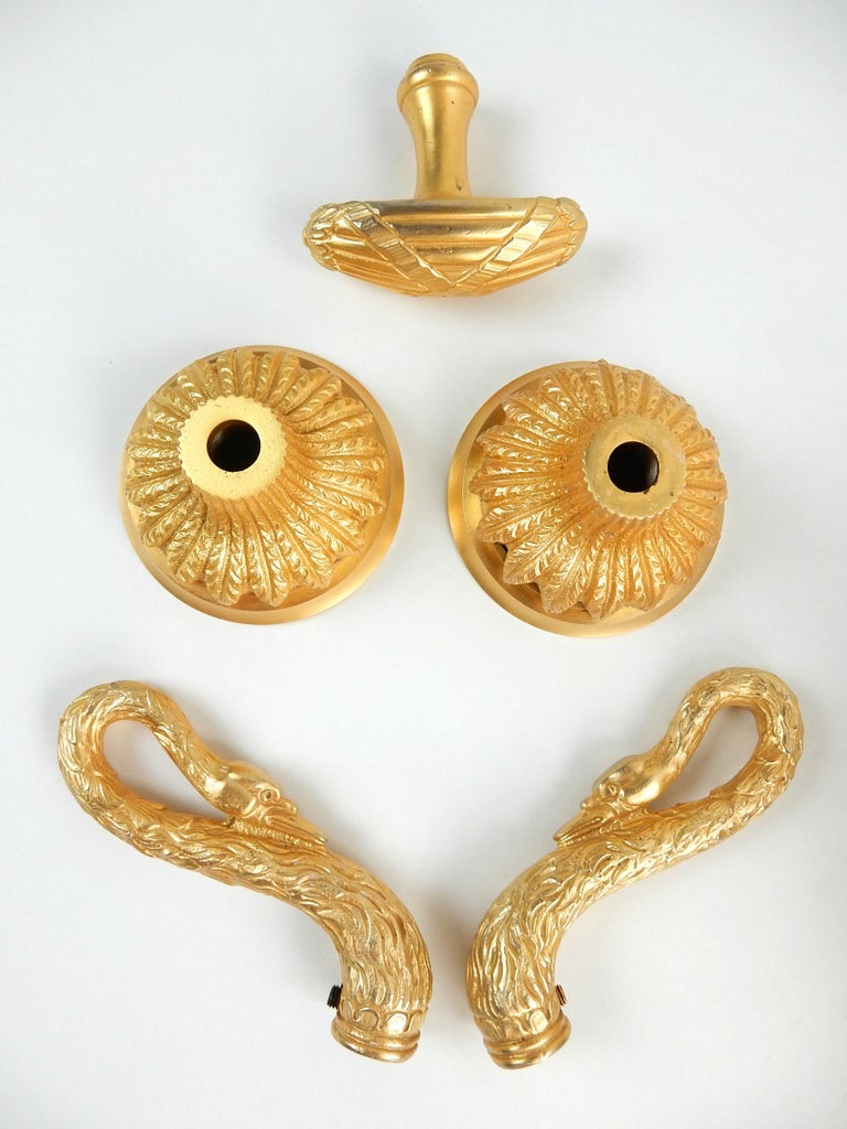 Huge golden swan bath tub spout and escutcheon from the early 1960s collection of Sherle Wagner. Set also includes figural swan hot and cold handles, wall escutcheon and flow T handle. All are 22-karat gold plated with gorgeous luster. No behind