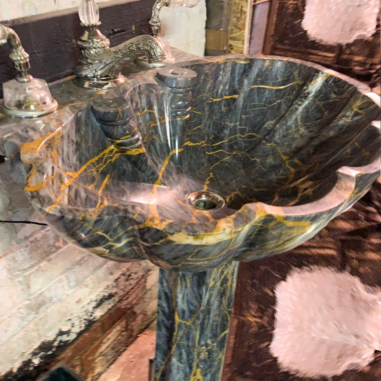 Sherle Wagner Marianella marble shell pedestal sink grey and amber stone sculpture, hand carved Italian marble, amber and gold veins in varied cool gray coloration. Faucets and all metal hardware pictured in this listing are not included with