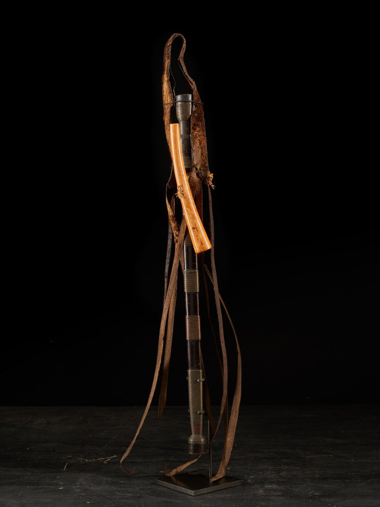 The Shi are an ethnic group located in the eastern part of the Democratic Republic of the Congo, (Zaire), mainly located in the South Kivu province. This old sword has a long steel blade with a thick central ridge, small notch to the tip, the steel