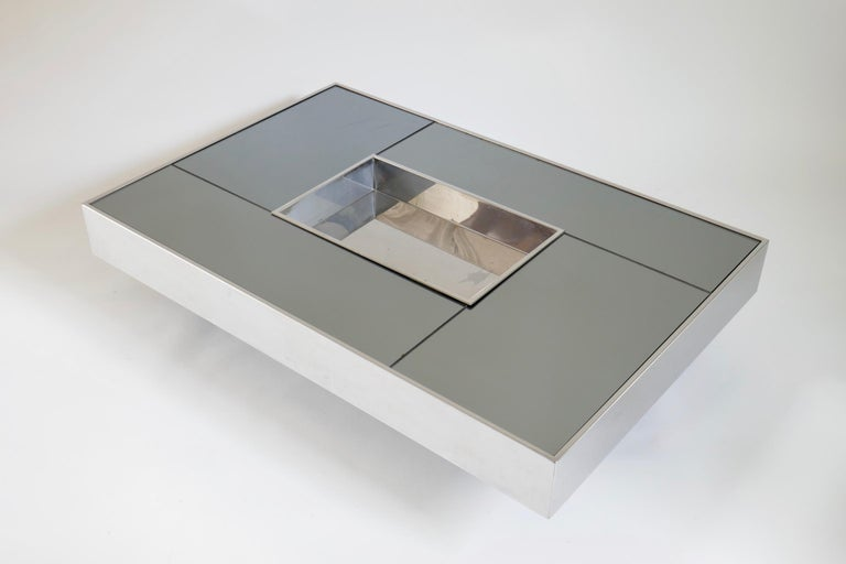 Stainless steel coffee table with smoked mirror top by Giovanni Ausenda, produced in 1970 by Ny Form Italy Similar to a design by Willy Rizzo.