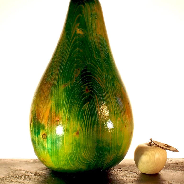 You'll feel like sinking your teeth into this shiny green pear sculpture, a unique handmade piece by artisan Pietro Arnoldi. This sculpture was made from solid fir wood and its stem is an antique nail. Shaped with a chainsaw and polished by hand,