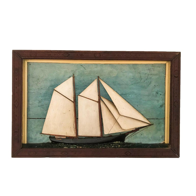 The shadow box depicts a two masted topsail schooner with painted background