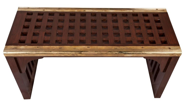 Original ship's teak decking converted into a waterfall design coffee table or bench. Found the old brass stair treads and added those along the edge. Components are circa 1960s-1970s. Sturdy and functional; a great re-purpose. Design by Deborah