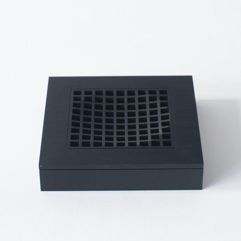 Shiro Kuramata's ashtray1. Made of black aluminum. Rather optical art object than usual astray.