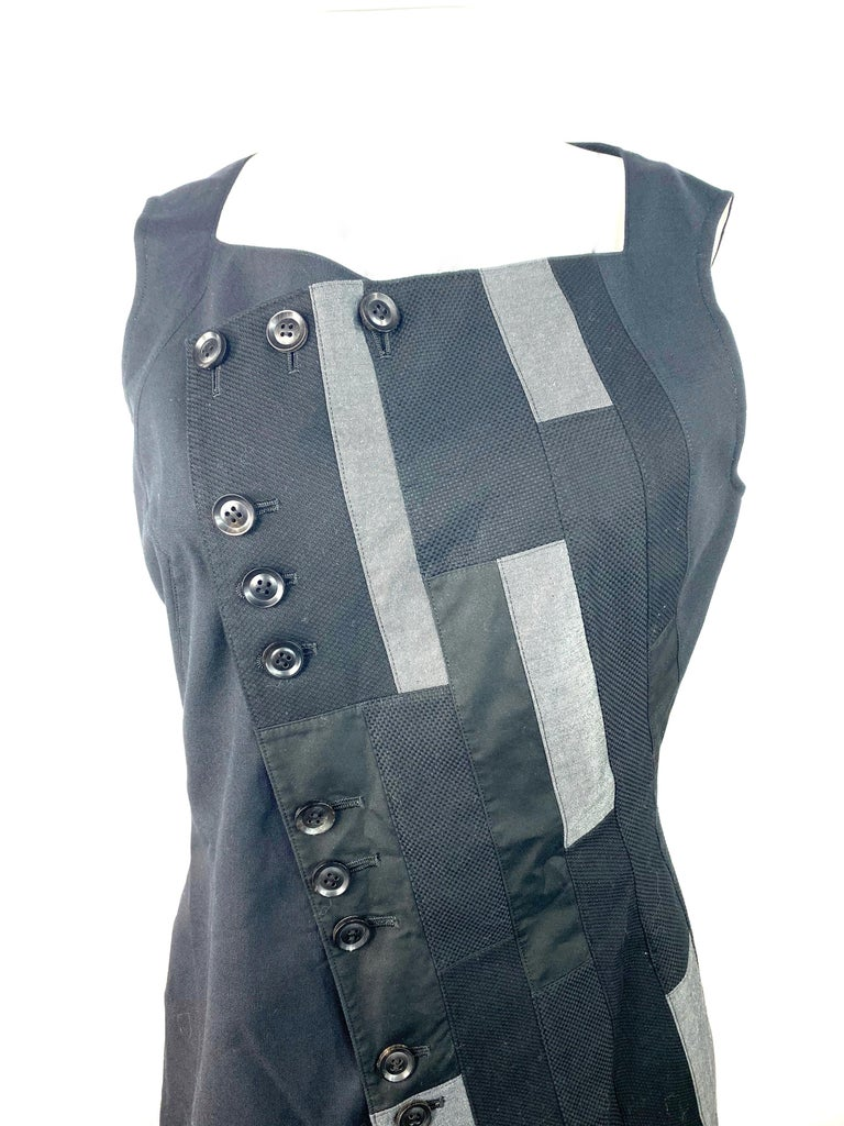 Product details:  Featuring asymmetrical design with rectangular grey and black patches detail.