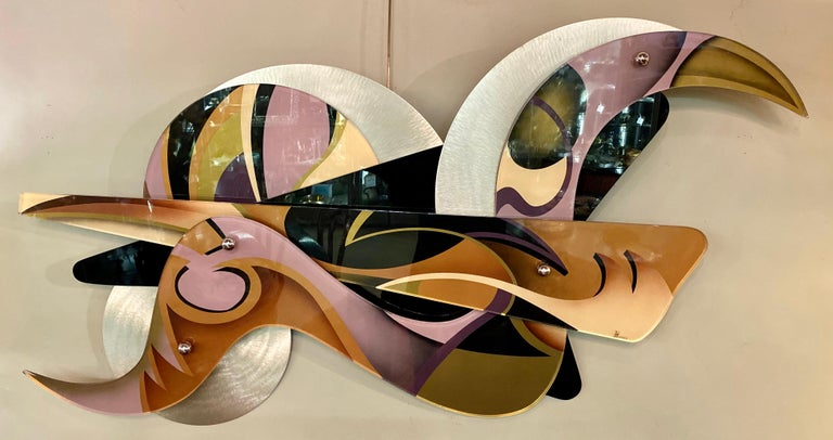 Shlomi Haziza Lucite metal abstract wall art sculpture signed H. Aziza. This sculpture from this highly sought after artist has the most brilliant of colors flowing from one section to another. This particular piece of art can hand vertically or