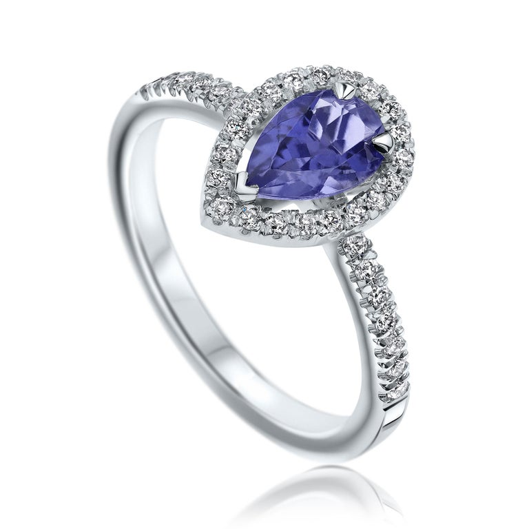 Shlomit Rogel - Pear Tanzanite & Diamonds Ring in 14K in White Gold  Pear shaped tanzanite halo style diamond ring, set with a purplish-blue clear 0.60 carat natural tanzanite gemstone.   In the ring there are additional 36 diamonds diamonds set in
