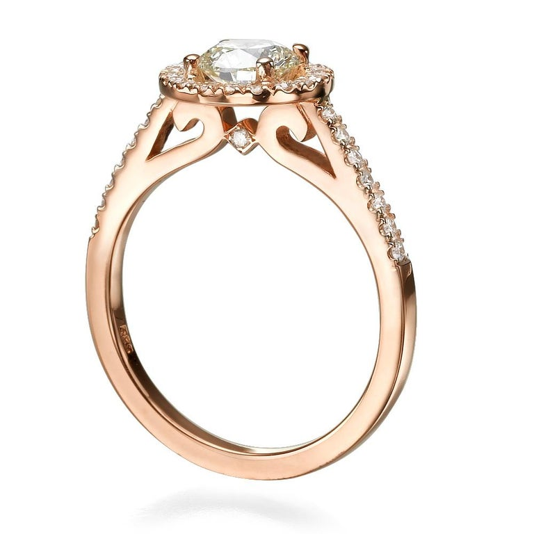 Shlomit Rogel - 1 Carat Diamond Ring Lenny Diamond Ring in 14k Rose Gold  SHLOMIT ROGEL's signature halo diamond ring is a gorgeous romantic ring set with all natural shiny excellent cut diamonds.  Center Diamond is a captivating 0.70 Carats round