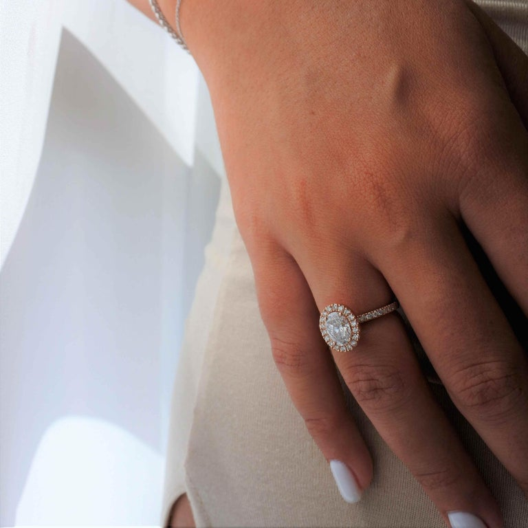 1.40 Carat EGL Certified Oval Shaped Diamond Halo Ring in 14 Karat Rose Gold In New Condition For Sale In Ramatgan, IL