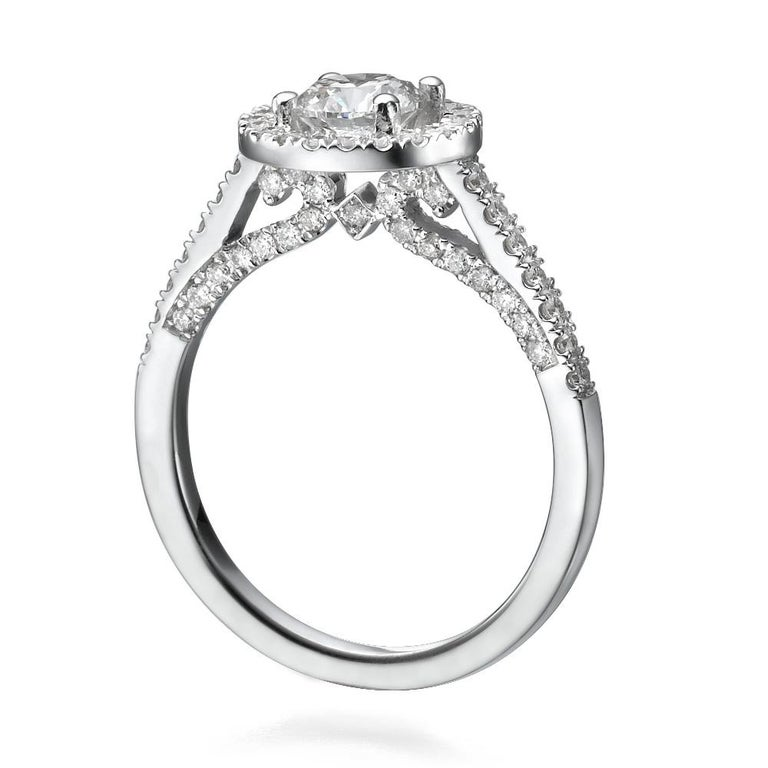 Shlomit Rogel - 1.62 CARAT EGL Certified Diamond Ring In 18K White Gold  Shlomit Rogel's signature halo diamond ring is a gorgeous engagement ringset with all naturalshiny excellentcut diamonds. Center diamond is a captivating 1.02 CARAT round