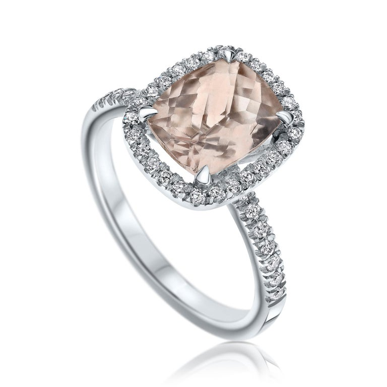 2.09 Carat Morganite and Diamonds Ring in 14 Karat White Gold - Shlomit Rogel - Gem Glam Collection  Cushion shaped morganite halo style diamond ring, set with a peachy clear 1.70 Carat natural morganite gemstone.  In the ring there are additional