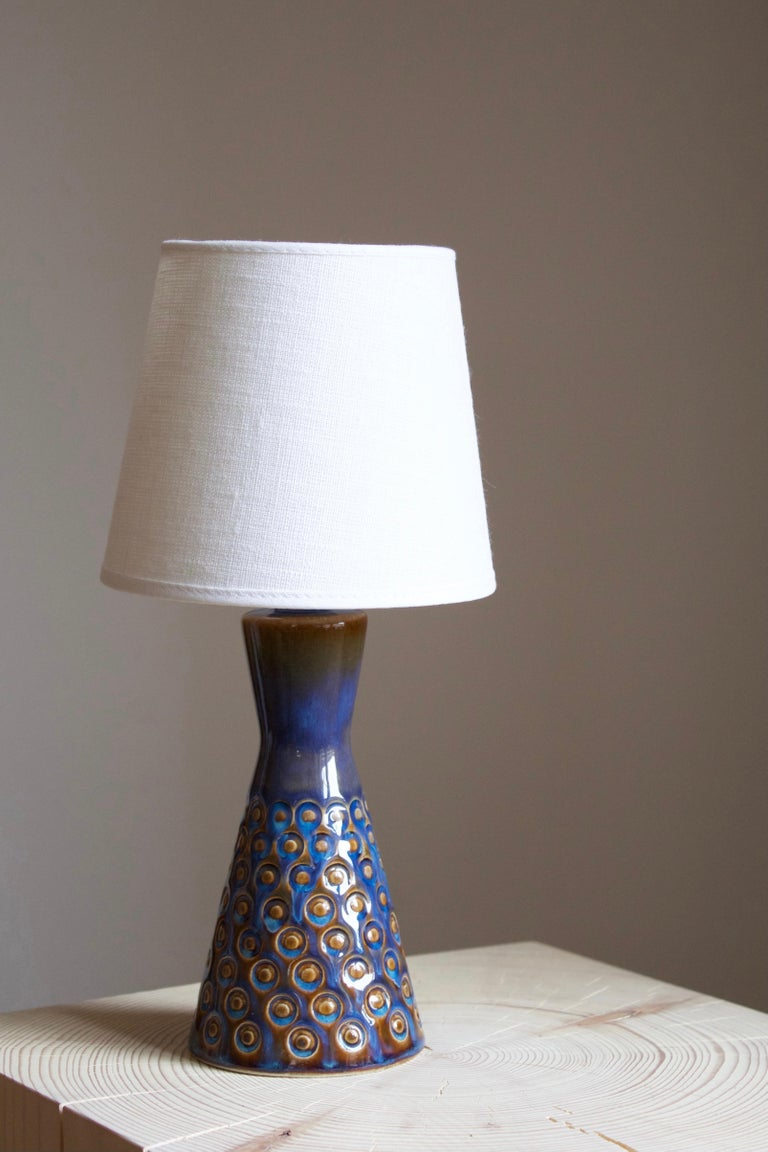 A small table lamp produced by Søholm Keramik, located on the island of Bornholm in Denmark.