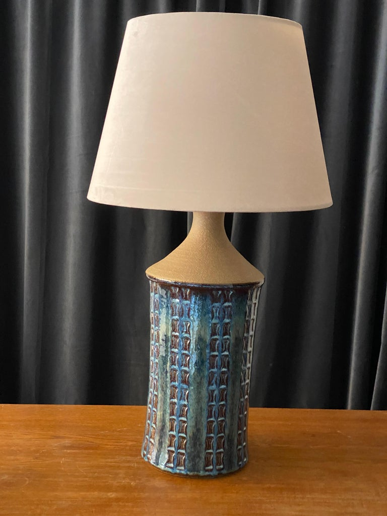 A pair of table lamps produced by Søholm Keramik, located on the island of Bornholm in Denmark. In a highly artistic blue / grey / beige glaze.  Lampshade is attached for reference and are not included in the purchase. Dimensions approximate,