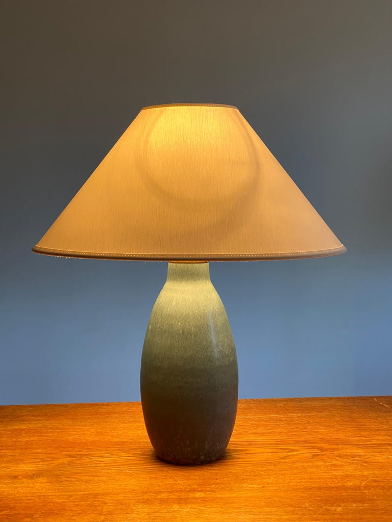 A table lamp produced by Søholm Keramik, located on the island of Bornholm in Denmark. In highly artistic blue glaze. 