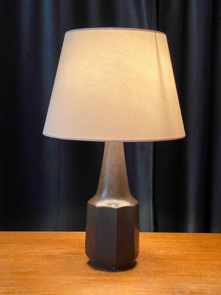 A table lamp produced by Søholm Keramik, located on the island of Bornholm in Denmark. In dark grey / brown glaze.   Lampshade is attached for reference and are not included in the purchase. Measured without lampshade.  Other ceramicists of the