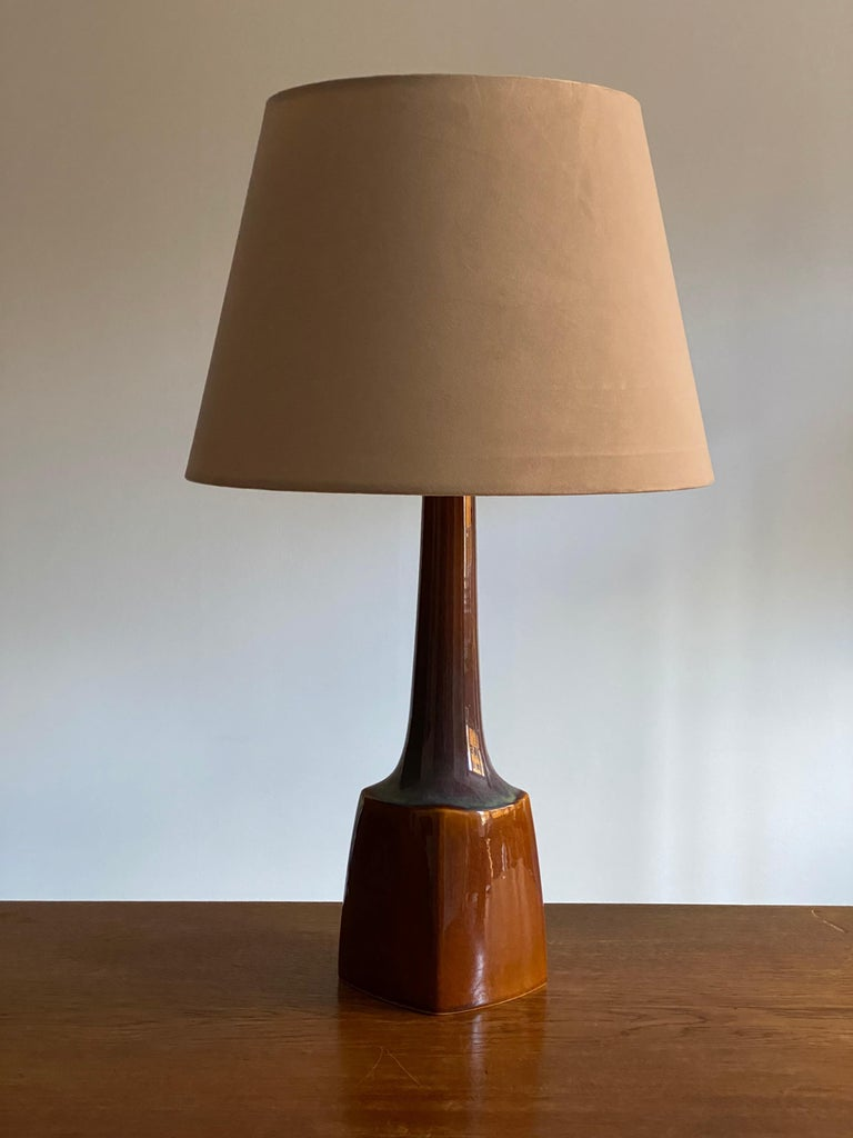 A table lamp produced by Søholm Keramik, located on the island of Bornholm in Denmark. In highly artistic blue / brown glaze. 
