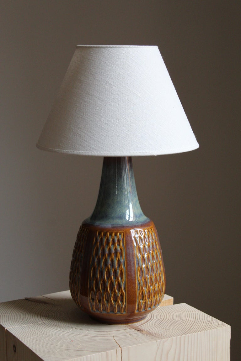 A small table lamp produced by Søholm Keramik, located on the island of Bornholm in Denmark.   Sold without lampshade, stated dimensions excluding lampshade.