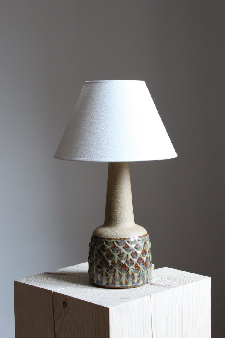A table lamp produced by Søholm Keramik, located on the island of Bornholm in Denmark.