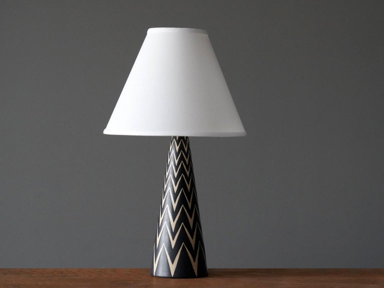 A table lamp produced by Michael Andersen Keramik. In hand painted stoneware 
