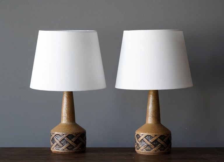 A pair of table lamps produced by Søholm Keramik, located on the island of Bornholm in Denmark. In a highly artistic brown / beige glaze. 
